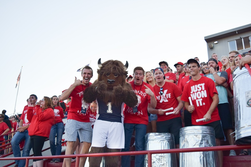 Brooks the Bison joins the crowd in cheering on the Dixie State University football team Saturday at Legend Solar Stadium. Photo by Camden Bennett.