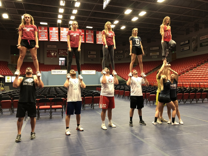 The Dixie State University cheer team has to have enough strength to be able to lift and hold each other up. Photo by Jessica Johnson.