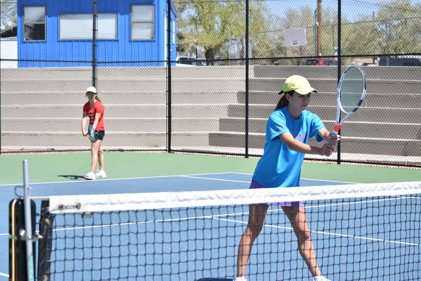 From left, Maria Kana Goldsmith and Frances Hina Goldsmith prepare for the serve to begin the point during practice on April 3 at Dixie High School. Photo by Kylea Custer.