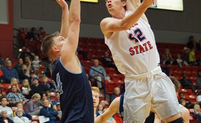 Austin Montgomery, a sophomore center from Gaineville, Georgia, shoots the ball against a Sonoma State defender on Friday in the Burns Arena. Photo by Alexis Winward.