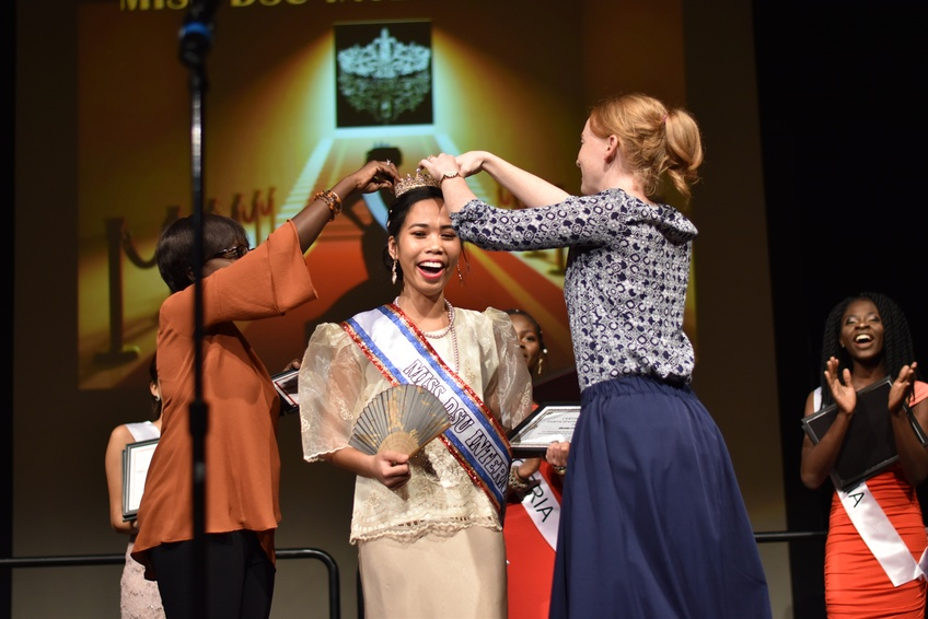 Miss Philippines Sheena Luy, a freshman biology major from Zamboanga City, Philippines, receives the crown as the first Miss DSU International Tuesday. Photo by Kylea Custer.