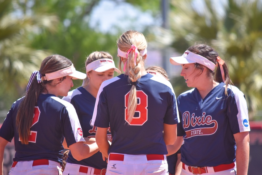 Hazel, number eight, holds a pow-wow with her infielders during game one against CBU on Saturday.