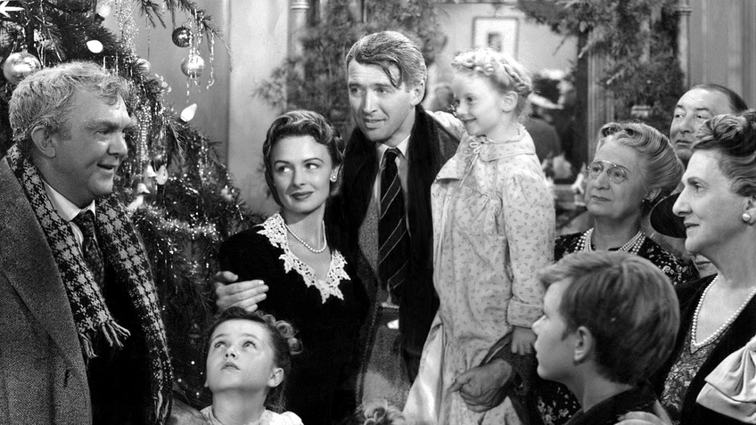 George Bailey is overjoyed to see his family after his ordeal. Courtesy of RKO Radio Pictures and Paramount Home Entertainment.