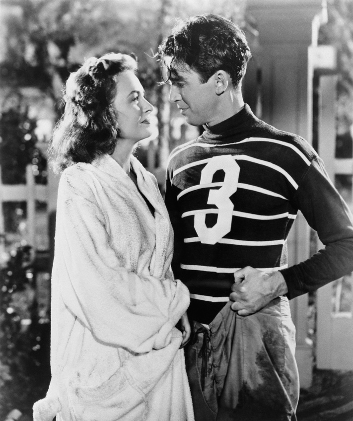 "Donna Reed and James Stewart embrace each other in ""It's A Wonderful Life."" Courtesy of RKO Radio Pictures and Paramount Home Entertainment."