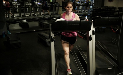 """Pollock said to tell others about your New Years goals. Allison Cavazos runs on the treadmill during the """"Cross Tread"""" class taught by Mercedes Owens at Tread Fitness in Dallas. TNS."""