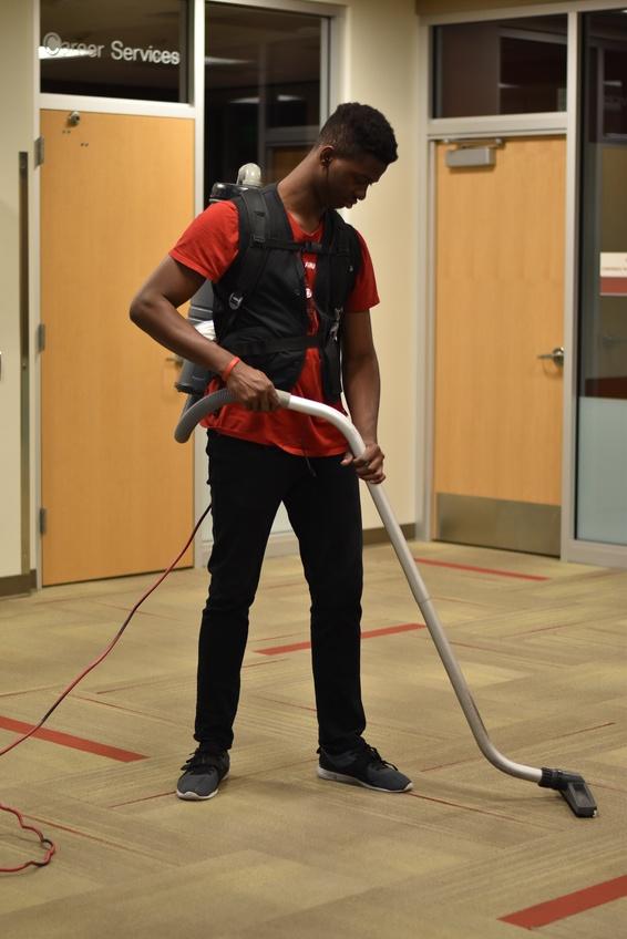 John Ailenmoagbon, a freshman accounting major from Benin City, Nigeria, vacuums the fifth floor of the Jeffrey R. Holland Centennial Commons building Feb. 28.