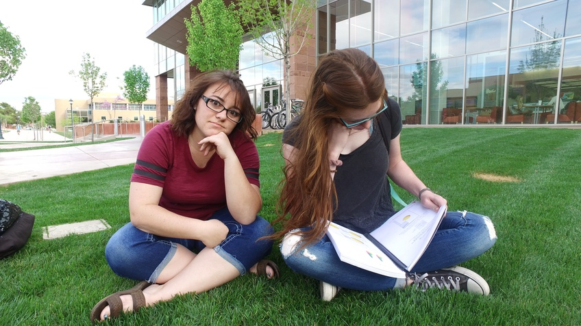 Tiffany Cottam, a junior elementary education major from St. George, waits impatiently for Katie Gordon, a freshman general studies major from American Fork, finishes reading. Photo by Alexis Winward