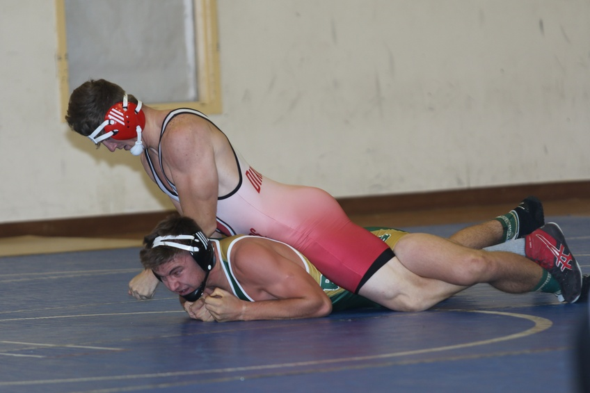 Kyler Kelsh leg locks his opponent at the Colorado State University Invitational. Courtesy of Wayne Briggs.