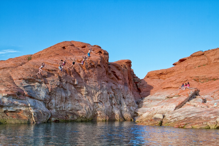 DSU students partake in a traditional summer activity by jumping of the rock at Sand Hollow State Park.