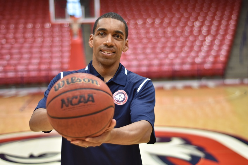 Assistant Basketball Coach Jeremiah Barnes, a Dixie State University alumnus from Compton, California, holds out a basketball the key element to the game he believes is a way of life.