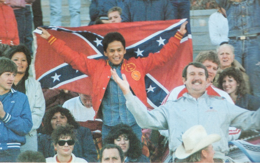 A student sports the Confederate flag at a football game in 1987. Picture from 1987 Confederate.