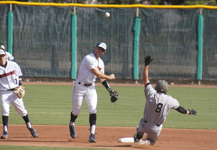 Senior infielder Tyler Mildenberg, a sociology major from Huntington Beach, California, turns a double play. Photo by Alexis Winward.