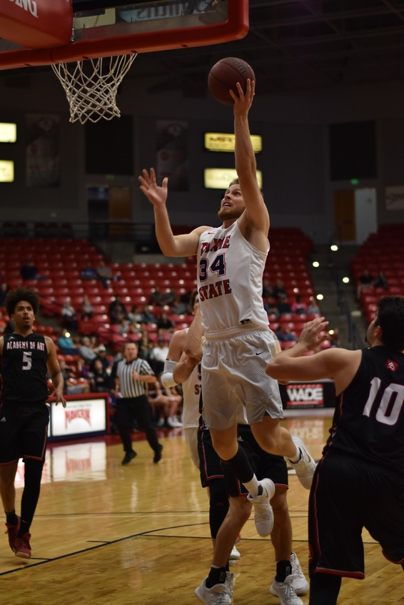 Senior forward Zac Hunter, a finance major from American Fork, does a lay-up for two points in the second half Saturday in the M. Anthony Burns Arena. Photo by Kylea Custer.