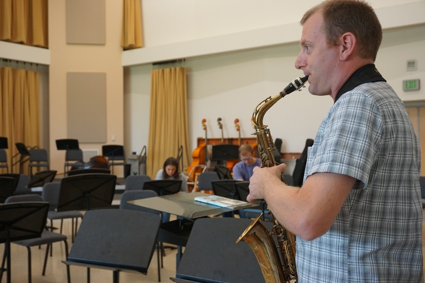 Bryant Smith shows off his love for the saxophone as he performs between teaching class. Photo by: Alexis Winward