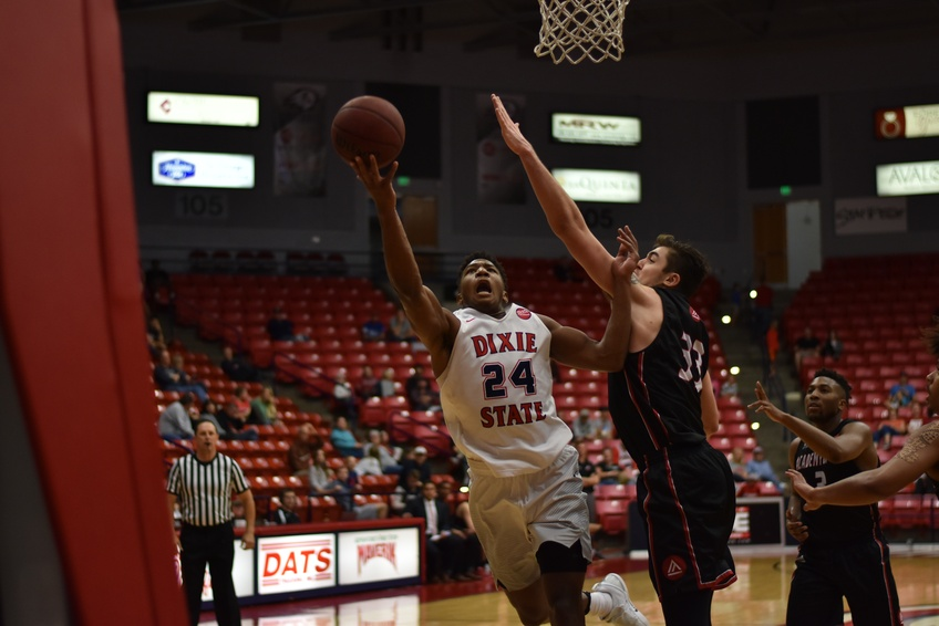 Senior guard Trevor Hill, a business administration major from Sandy, goes for a lay-up Saturday against the Academy of Art University. Photo by Kylea Custer.