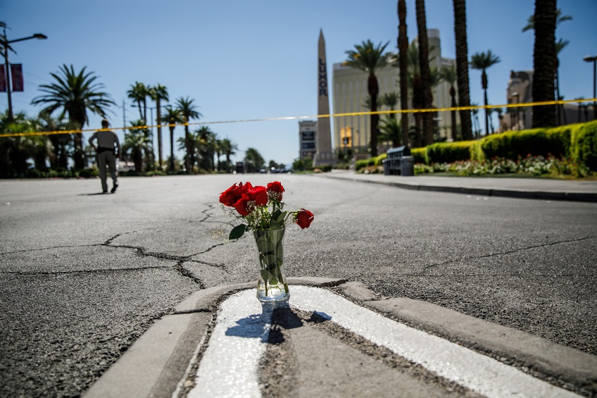 A lone vase of flowers left on Las Vegas Blvd. and Reno Ave. for the victims of the mass shooting on Oct. 2, 2017 in Las Vegas. TNS.