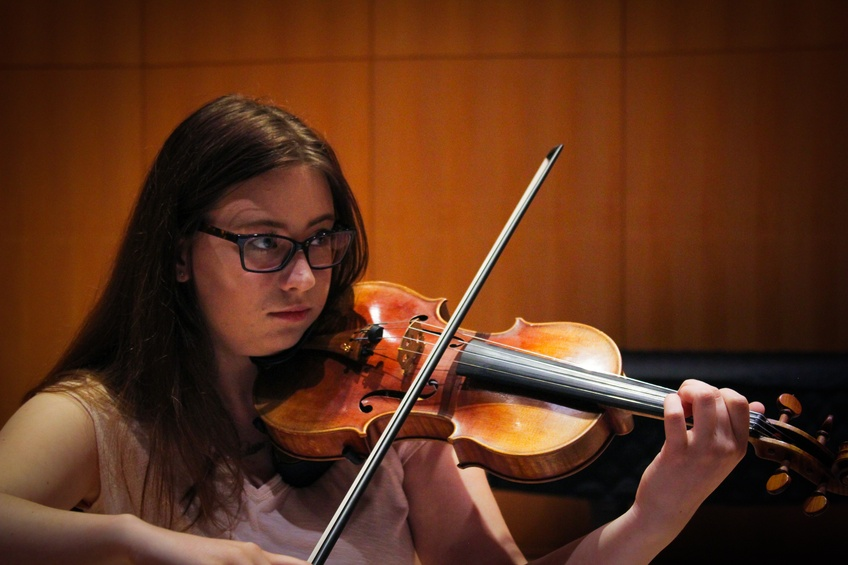 Katt Phillips, a sophomore psychology major from St. George, plays the violin in her string quintet ensemble.