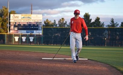 Junior infielder Joe Raymond, a finance major from Foresthill, California, drags the infield of Bruce Hurst Field Jan. 10. Photos by Kylea Custer.