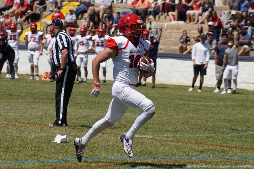 Sophomore wide receiver Brad Duran, a integrated studies major from Corona, California, runs into the end zone in the Dixie Sunbowl.