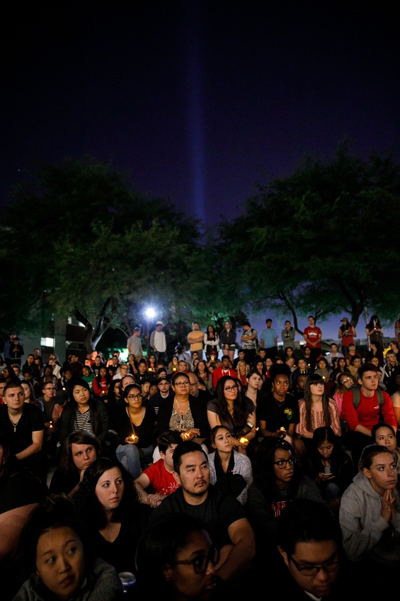 UNLV students gather for a candlelight vigil for the victims of the mass shooting that killed 59 people and injured more than 500 on October 2 in Las Vegas. TNS.