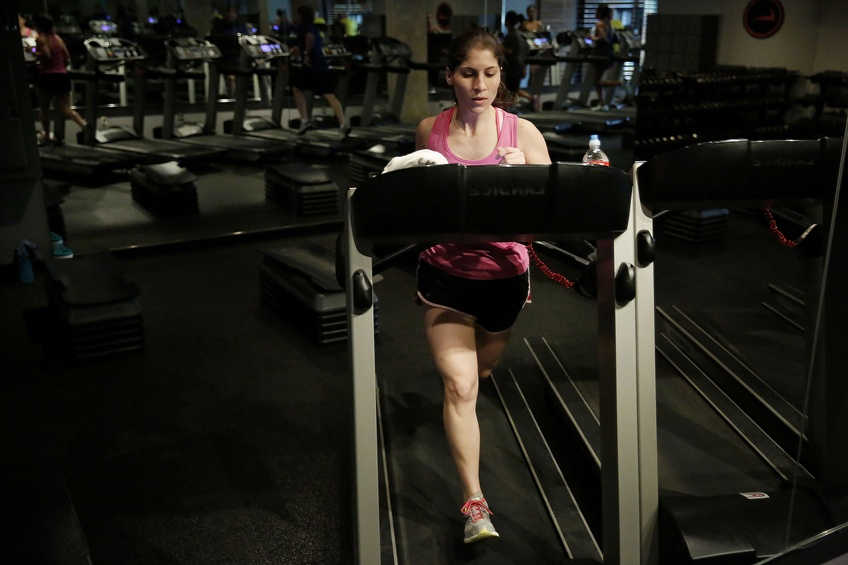 "Pollock said to tell others about your New Years goals. Allison Cavazos runs on the treadmill during the ""Cross Tread"" class taught by Mercedes Owens at Tread Fitness in Dallas. TNS."