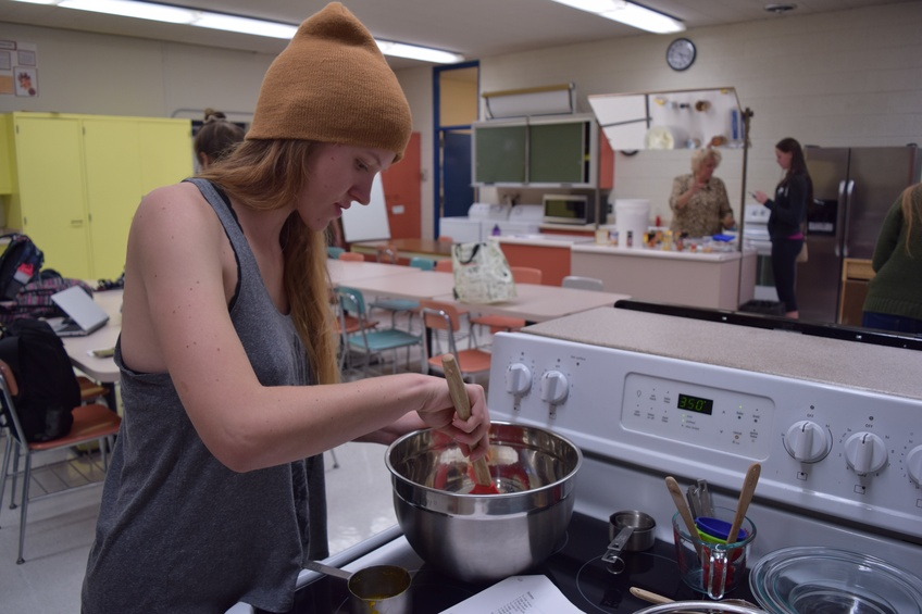 ea Roth, a senior biology major from Pueblo, Colorado, mixes ingredients together in preparation to make pumpkin bread Monday. Photo by Camden Bennett.