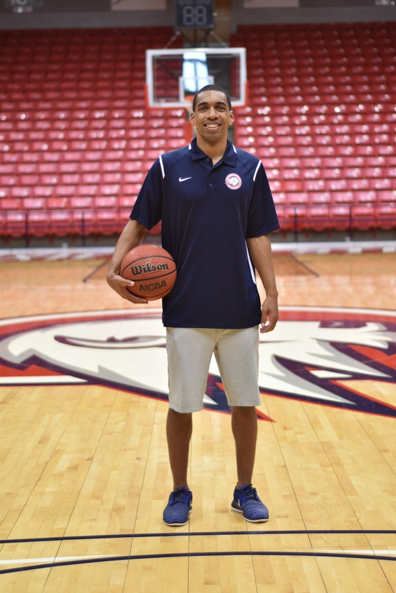 Barnes stands inside the M. Anthony Burns Arena on the very court he played on five years ago as a Dixie State University student. Photos by Kylea Custer.