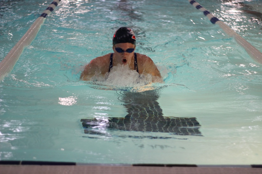 Emilee Sichz, a sophomore exercise science major from Ogden, races to beat her personal record in the 200 meter breast stroke Jan. 27. Photo by Aubrey Shipley.