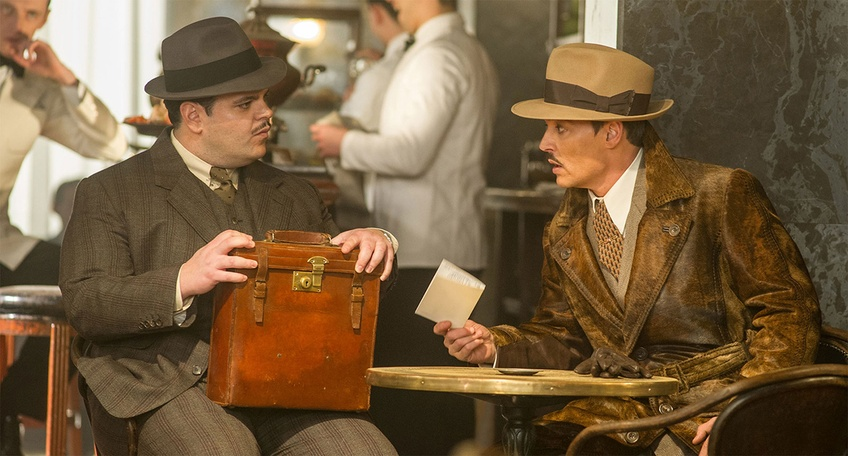 Josh Gad and Johnny Depp as Mr. McQueen and Mr. Ratchet in Murder on the Orient Express. Courtesy of 20th Century Fox.