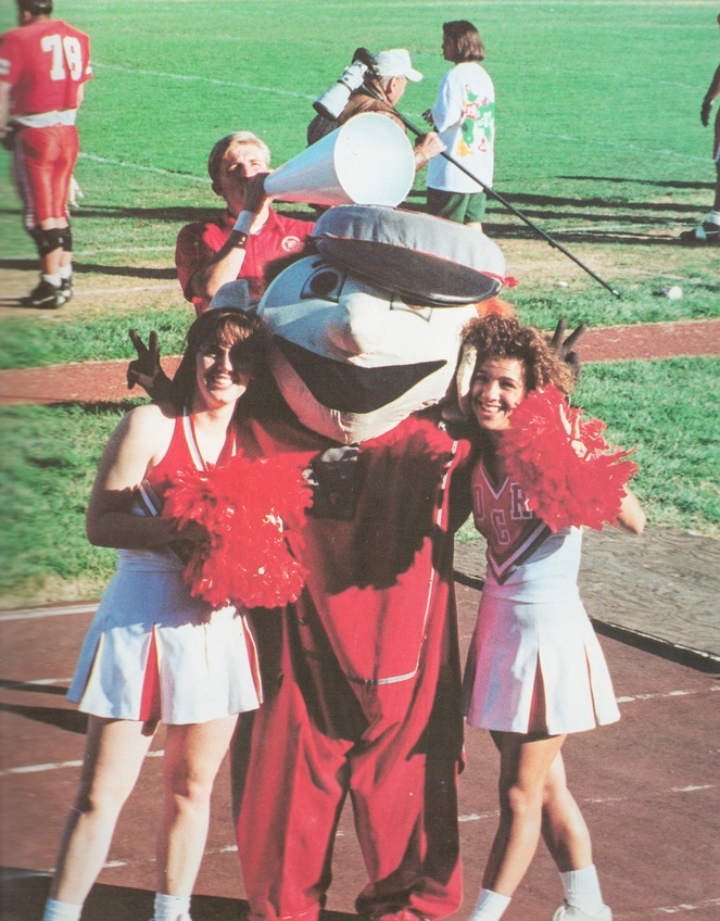 Cheerleaders Kelli Bryan and Misty Kay snap a picture with Rodney Rebel the school mascot. Picture from the 1994 Confederate.