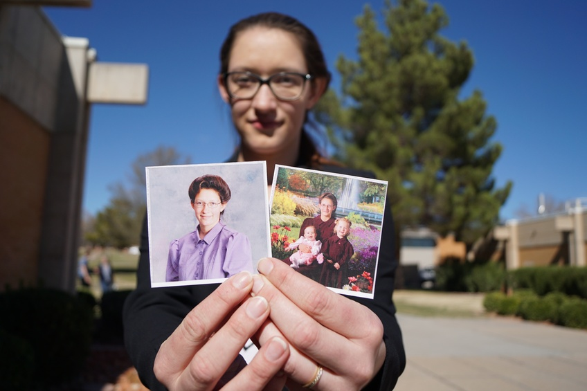 Jessica Chatwin, a freshman media studies major from Hildale, shows photos from her childhood growing up in the FLDS religion. Photos by Alexis Winward.
