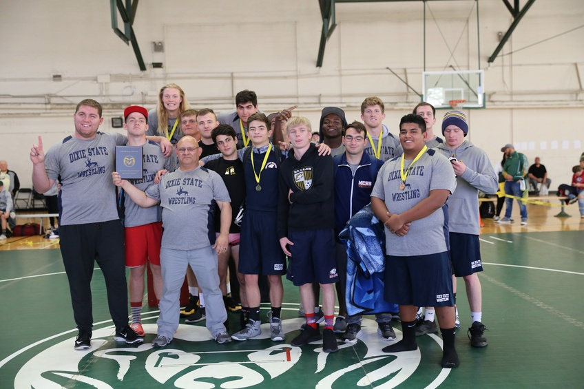 The Dixie State University wrestling club holds up their championship plaque from the Colorado State University Invitational. Courtesy of Wayne Briggs.